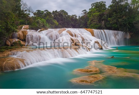 Shutterstock A complete view of the most beautiful cascade of the Agua Azul waterfalls, which color turquoise due to sediments and minerals in the right season, near Palenque, Mexico.