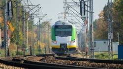 A complex system of electrification of the railway and the train on the rails