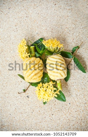 a composition of exotic fruits. exotic Thai fruit with flowers. pineapples and flowers.  #1052143709