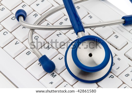 A computer keyboard and stethoscope. IT for physicians. - stock photo