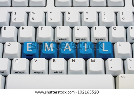 A computer keyboard with blue keys spelling email, Checking your email