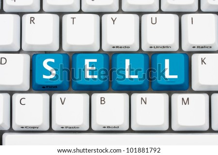 A computer keyboard with blue keys spelling Sell, Selling on the internet
