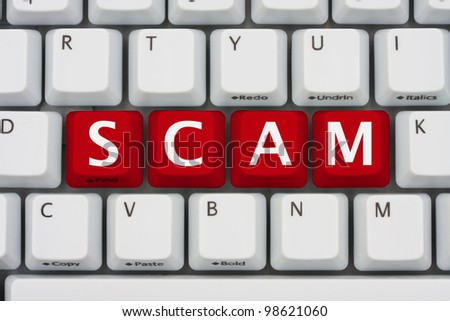 A computer keyboard with red keys spelling scam, Internet Scams
