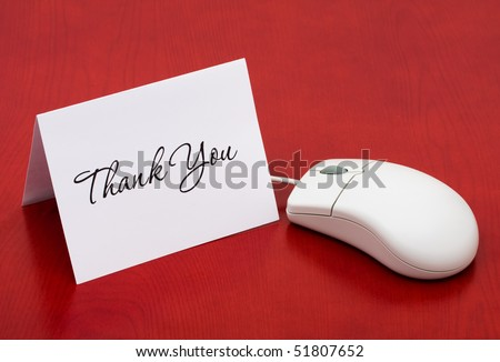 A computer mouse with a thank you card on a red background, Thank You for your online purchase