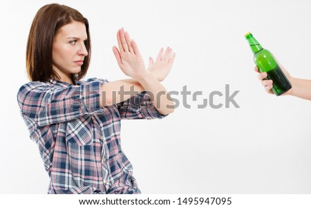 A concept of alcoholism : Young brunette woman in saying no to alcoholic beverage. #1495947095