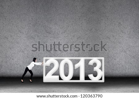 A concept of businesswoman effort in 2013 for new year