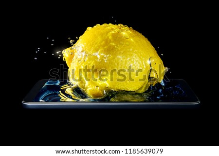 A conceptual creative 3D volumetric photo of a lemon close-up in splashes of water and sunlight falling into the water in a smartphone isolated on a black background.