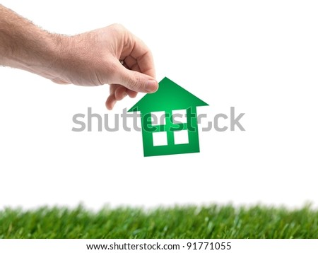 A conceptual house image held by a hand