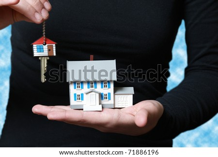 A conceptual image of someone receiving their key to their new home.