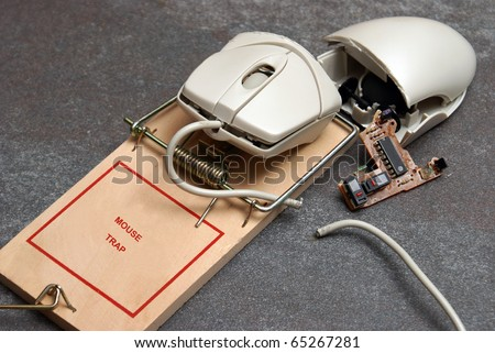 A conceptual photo involving a computer mouse and trap to give meaning to ideas such as hacking, errors, and many others.