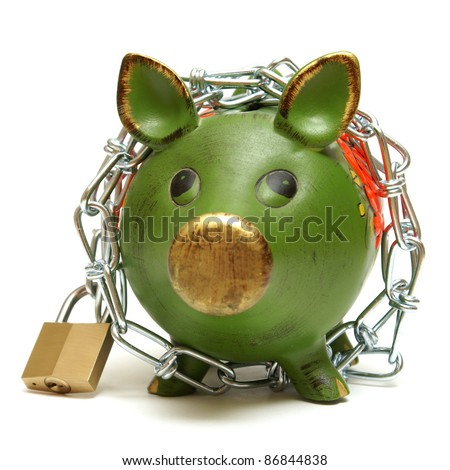 A conceptual shot of an isolated piggy bank that is bound by chains to give representation to protecting your money.