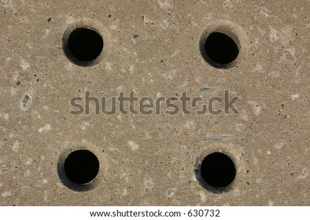 A Concrete Paving Slab With Drainage Holes Stock Photo