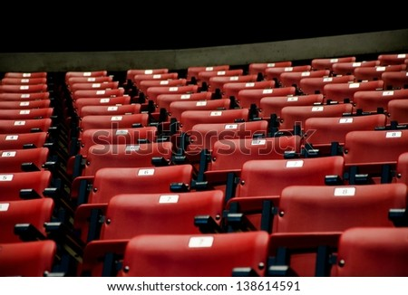 A conference room full of red seats