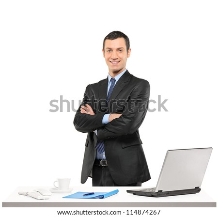 A confident businessman posing at his workplace isolated on white background