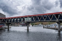 A connector bridge joining two piers at the inner harbor in baltimore maryland on an overcast day.