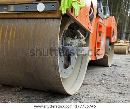 A construction vehicle steam roller close up.