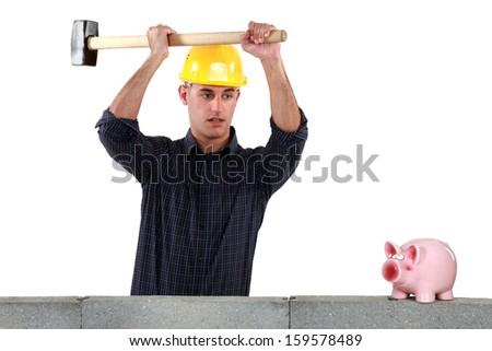 A construction worker about to open a piggy bank with a sledgehammer.