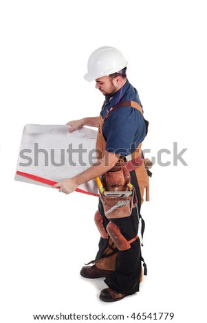 a construction worker looking at blue prints isolated
