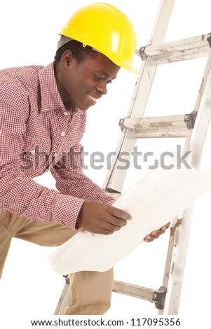A construction worker looking at his plans with a smile on his face