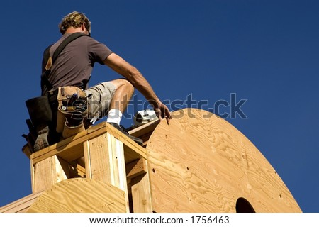 A construction worker measures.