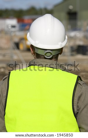 A construction worker on site and dressed in safety clothing