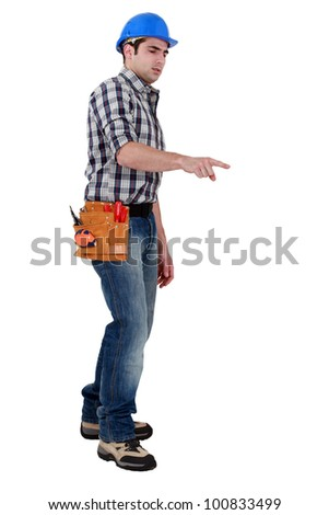 A construction worker pointing at a direction.