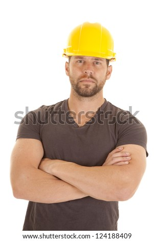A construction worker with his arms folded and a serious expression on his face.