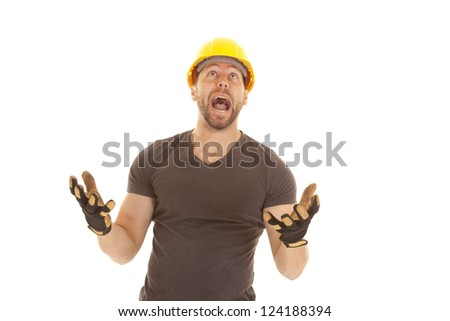 A construction worker yelling up at something.