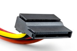 A 15 contacts serial ATA plug for powering a hard disk or CD drive coming from a computer power supply, isolated on a white background.