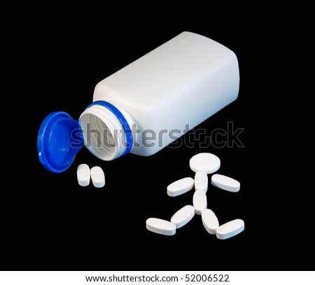 A container for pills and a man built out of pills next to him.