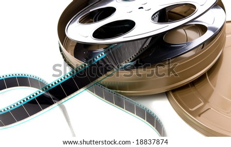 A container of film strip, film reel and film can on a white background