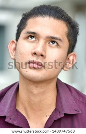 A Contemplative Young Filipino Male