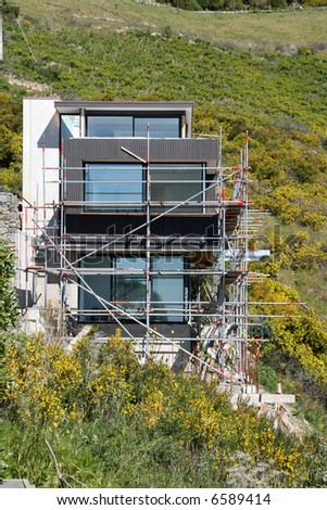 A Contemporary Designed House Built Into The Hill Stock