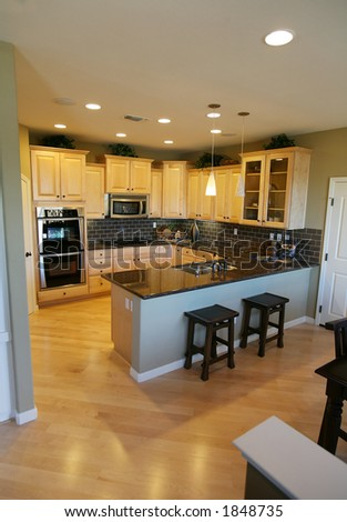 A contemporary kitchen in an upscale home interior - stock photo