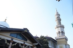 a contemporary mosque that has a tower. traditionally, the tower was for someone to call to prayer so can be heard from all directions.