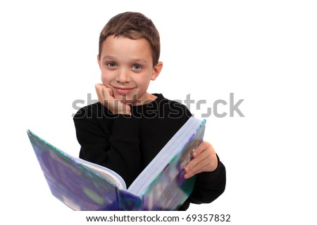 stock photo : A content eight year old boy holds a textbook from his grade shool homework, on a white background