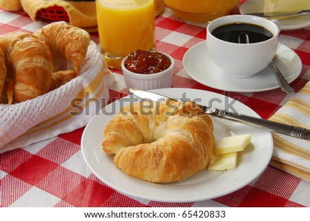 A continental breakfast served on a picnic table