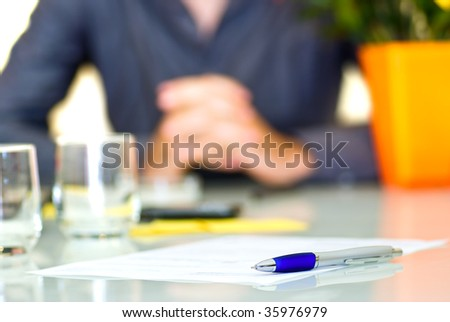 A contract in a desk with pen. Ready to sign contract