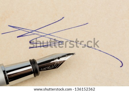 a contract or document is signed by hand with a fountain pen.