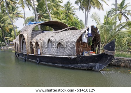 A converted rice barge ( kettuvallam ) on the backwaters of Kerala, India