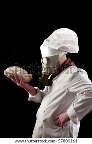 a cook with a gas mask with a radioactive chicken