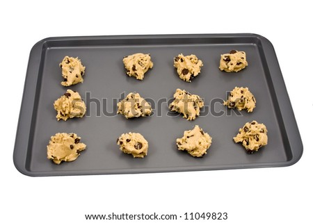 A cookie sheet of chocolate chip cookies ready for the oven.