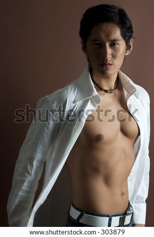 A cool asian model in an open white shirt