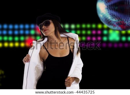 A cool disco woman on a black background of lights