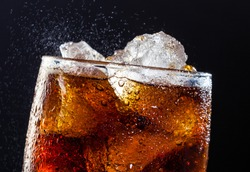 A cool glass of cola drink with ice, bubbles and fizz