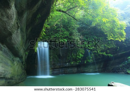 A cool refreshing waterfall tumbling down the cliff into an emerald pond hidden in a mysterious forest of lush greenery ~ Beautiful river scenery of Taiwan in springtime  #283075541