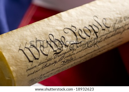 A copy of the United States Constitution on an American Flag Background