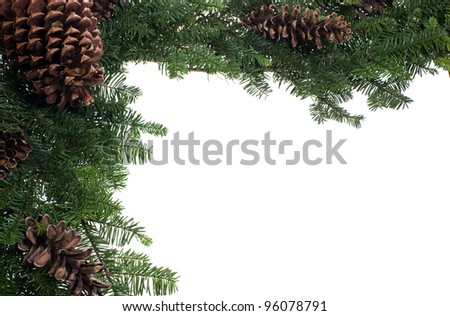 A corner border for Christmas with boughs and cones