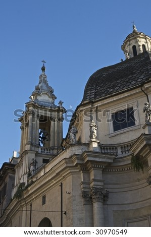 A cornice and belfry on a Catholic church in Rome, Italy (http://www.artistovision.com/religion/italian-church-belfry.html).