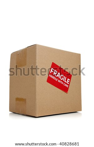 a corrugated cardboard moving box with a fragile sticker on a white background